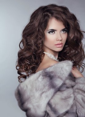 Beauty Fashion Model Girl in Mink Fur Coat. Beautiful Luxury Win
