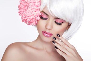 Beauty Blond Female Portrait with lilac flower. Beautiful Spa Wo