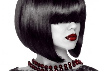 Fashion Woman with Black short hair style. Girl with fringe over