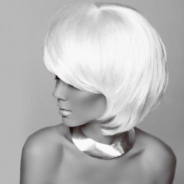 Hairstyle. Fashion blonde woman. White Short Hair. Beautiful gi