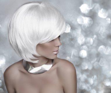 Hairstyle. Fashion blonde woman. White Short Hair. Beautiful gir