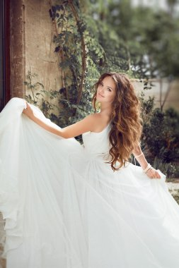 Beauty fashion bride girl gamboling with wedding blowing dress,