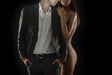 Naked brunette and man in suit