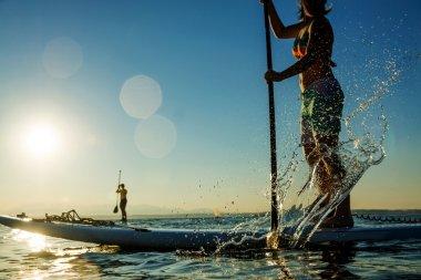 Women paddling stand up paddle board