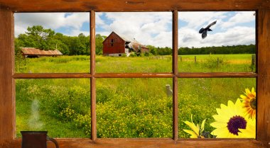 Country landscape seen through the farm house window.