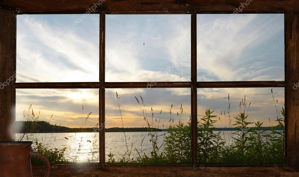 Summer sunset seen through the cottage window.