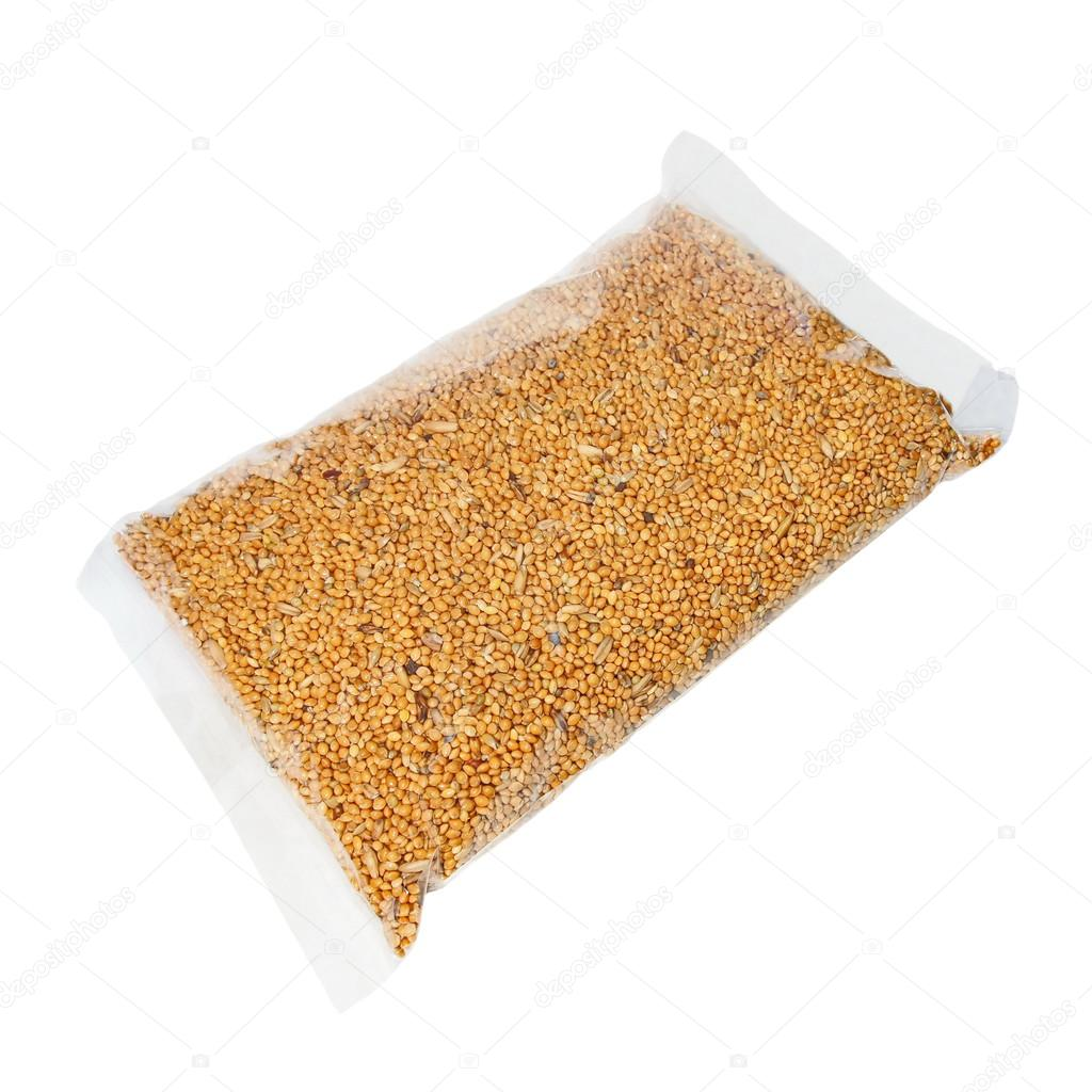 Packing seed mixture isolated on white background, food for Budgies