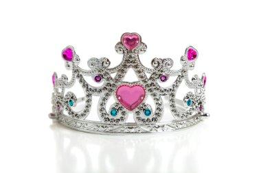 A child's toy princess tiara on a white background