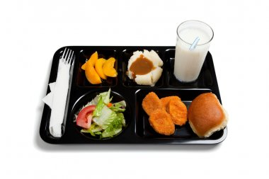 A black school lunch tray on a white background