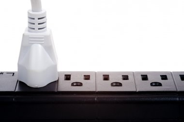 A black power strip with empty outlets