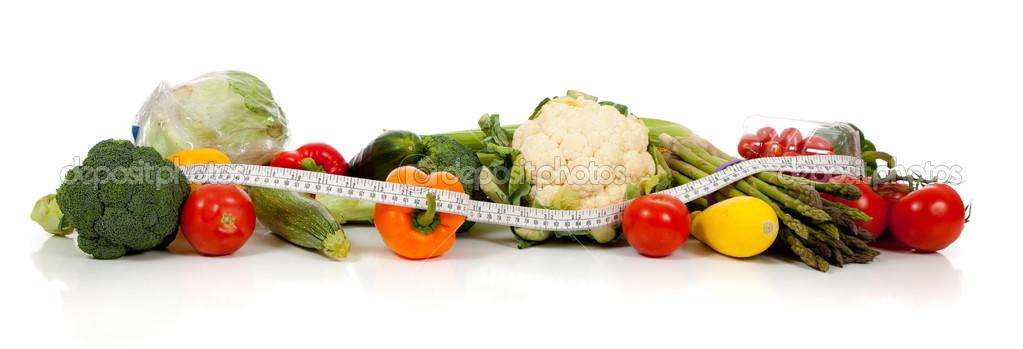 Wiersz Warzywa I Centymetrem Na Biały Zdjęcie Stockowe