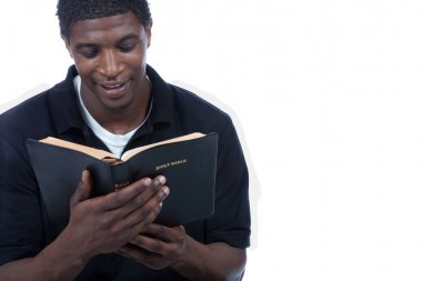 Young black man reading bible