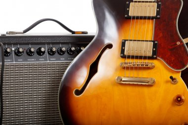 Electric guitar and amplifier on white background