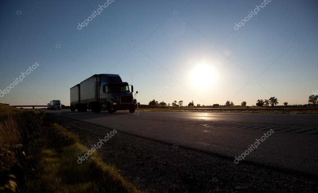 A semi-trailer driving down the highway