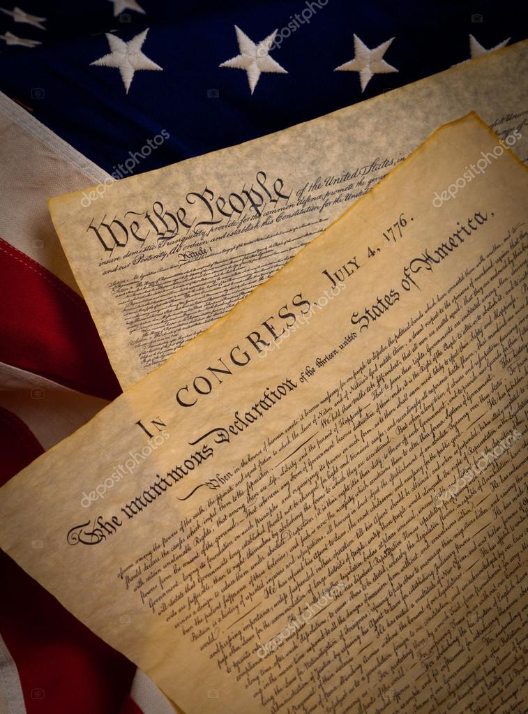 The United States Constitution and Declaration of Independence on a flag ba