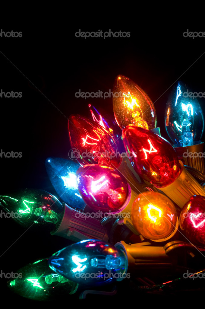 brightly colored christmas lights on a black background photo by miflippo