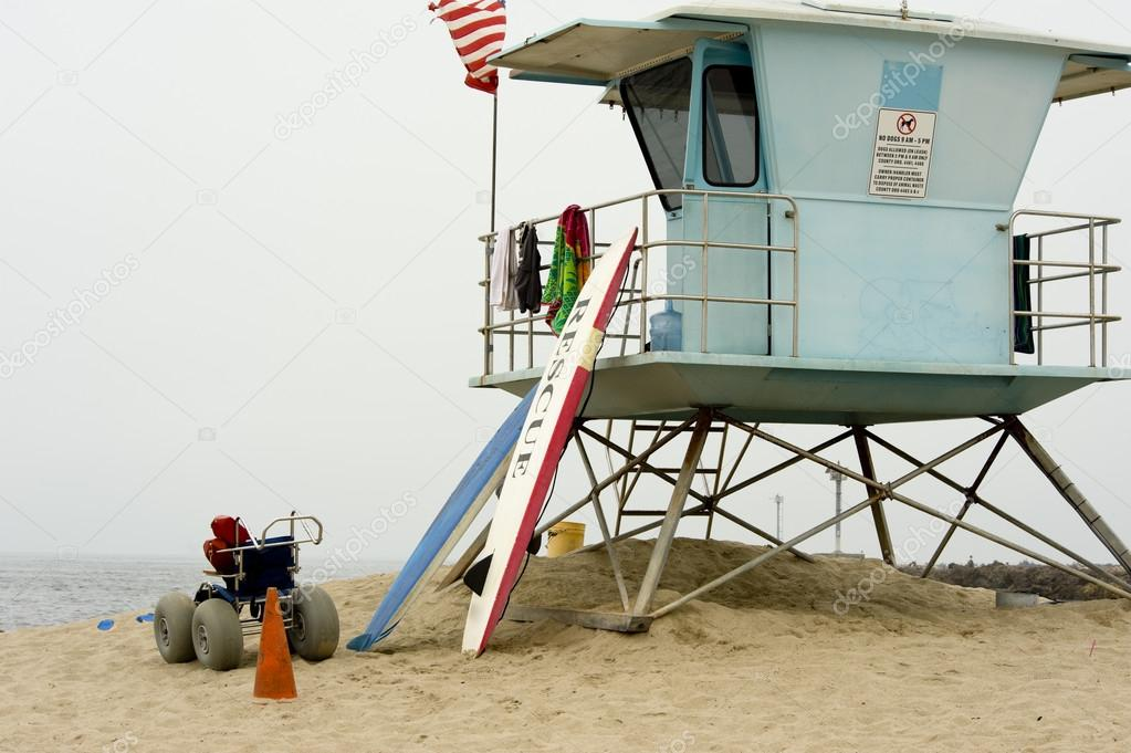 3290fc7571e7 A lifeguard shack or hut on a beach with surfboards etc — Photo by miflippo