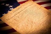 Photo United States Declaration of Independence on flag background