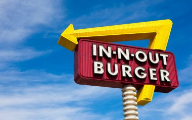 In-n-Out burger sign in front of blue sky