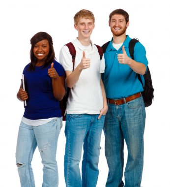 Three young college students showing the thumbs up sign