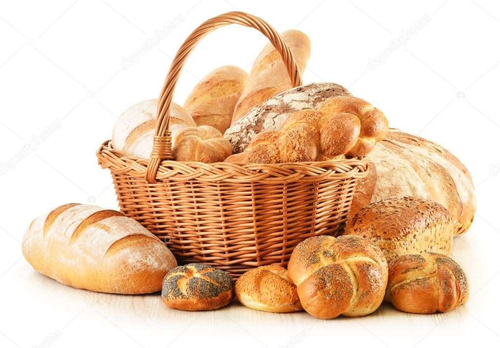Bread and rolls in wicker basket isolated on white