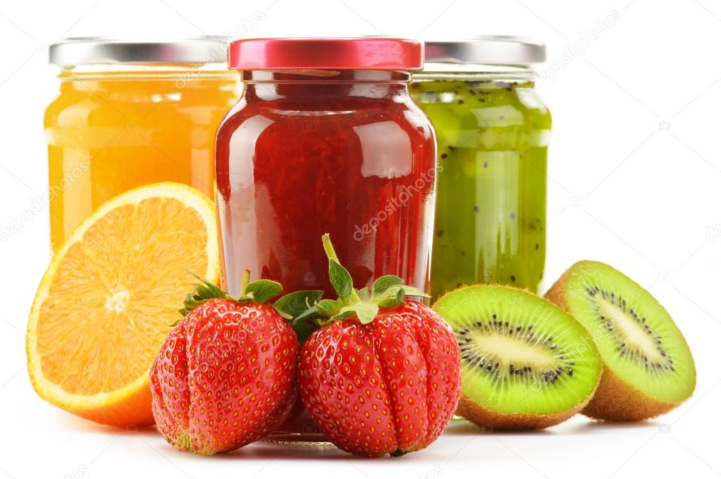 Composition with jars of fruity jams on white. Preserved fruits