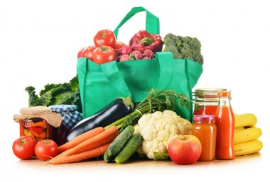 Green shopping bag with assorted grocery products isolated