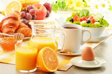 Breakfast with coffee, orange juice, croissant, egg, vegetables and fruits stock vector
