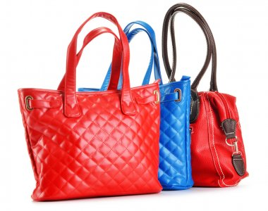 Three leather handbags isolated on white