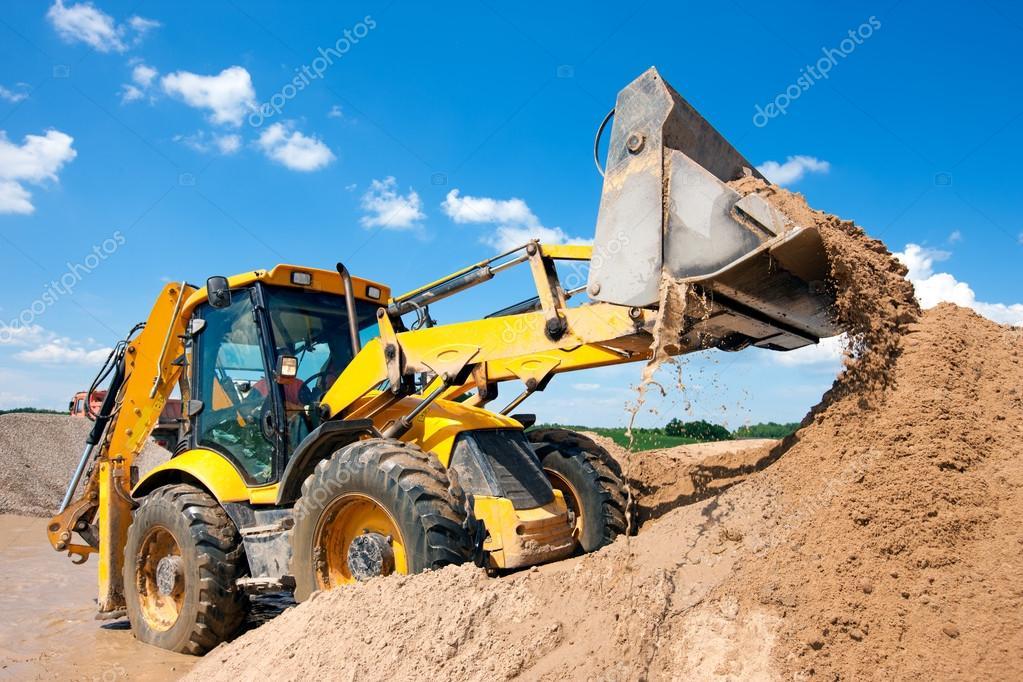 Excavator machine unloading sand with water