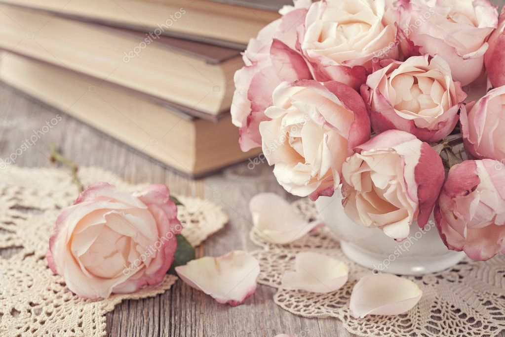 Pink roses and old books