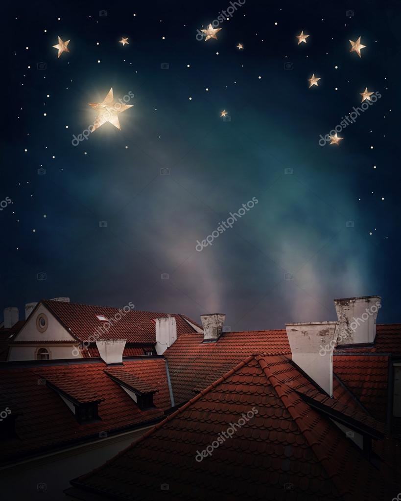 Rooftops and night sky