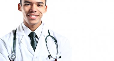 Young attractive black medical doctor isolated