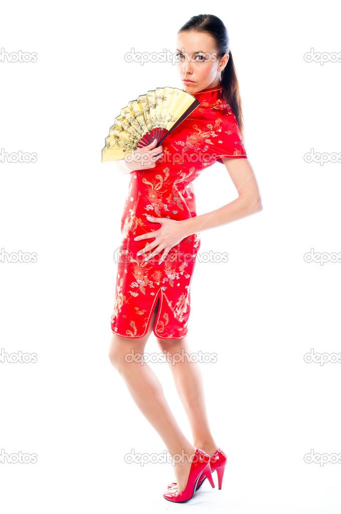 8914e2f9cf2f donna in un vestito cinese rosso — Foto Stock © korvin79  30423523