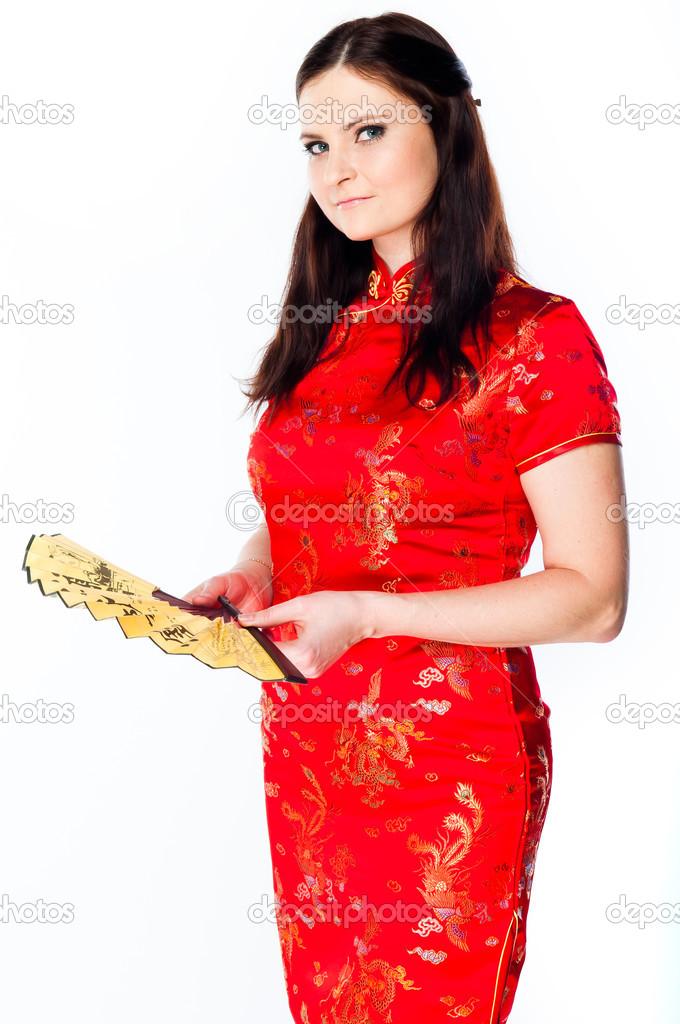d25b6d0fd3db donna in un vestito cinese rosso — Foto Stock © korvin79  30423857