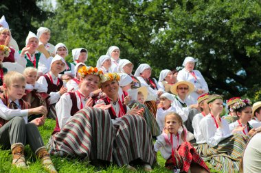 RIGA, LATVIA - JULY 06: People in national costumes at the Latvi