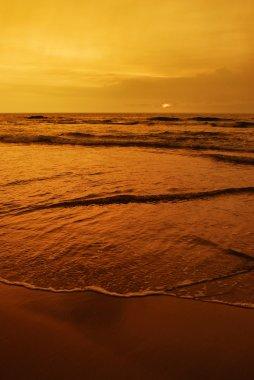 Sunset over the ocean beach