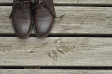 Dark brown boots on wooden floor