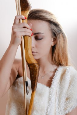 Beautiful girl holding arrow