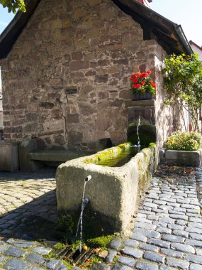 old mill with water basin in fairy tale town of Steinau