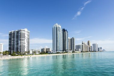 beautiful beach with condominiums and skyscraper in Sunny Island