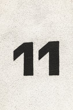 House number 11at the wall