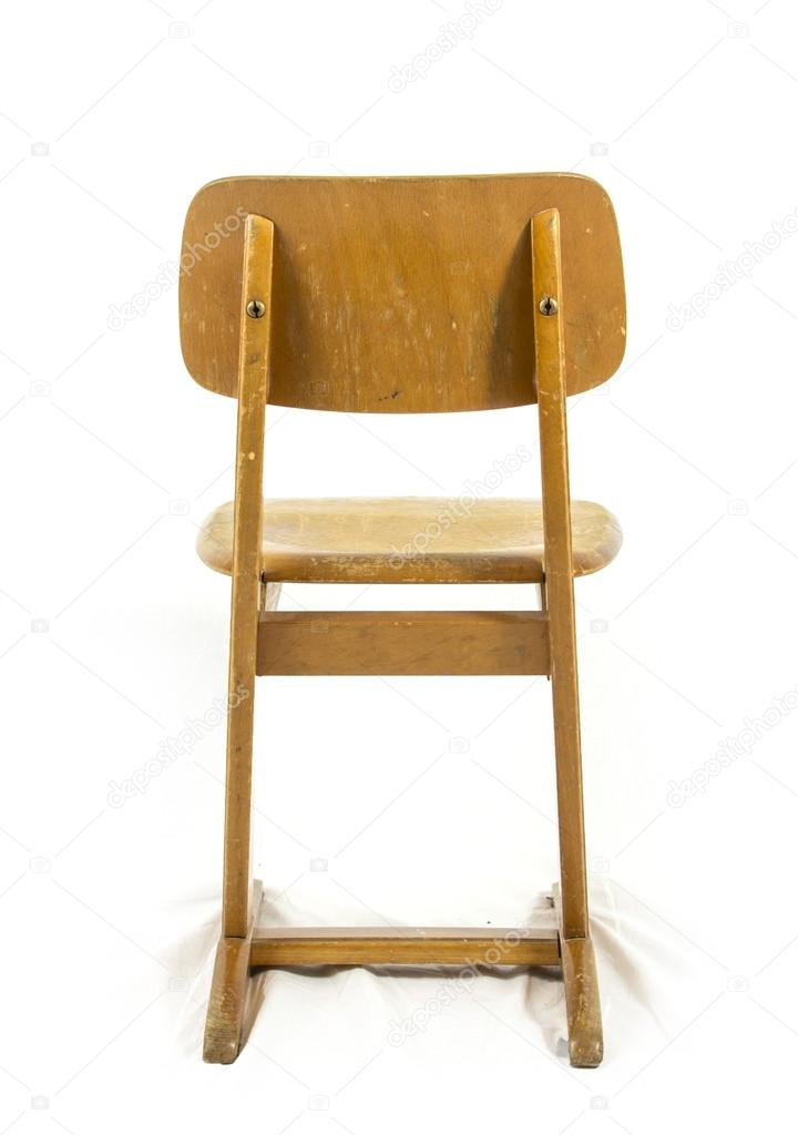 old used wooden school chair for the young pupils stock photo