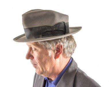 man with hat in elegant suit