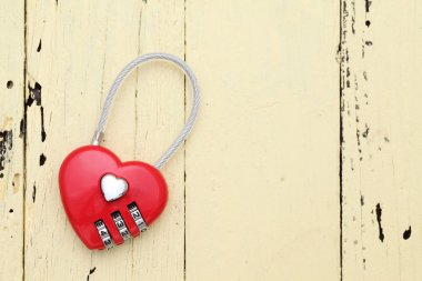 Red hart shaped padlock on wooden background stock vector