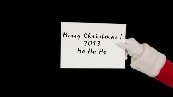 Santa claus Veselé Vánoce, které představují bílý list posílá pusu a vlny, černý