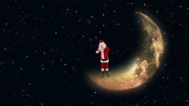 Santa claus na měsíci a čeká na soby