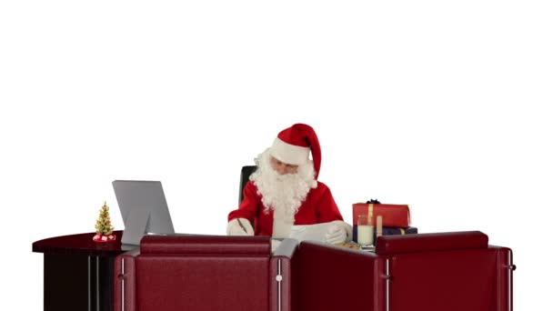 Santa Claus reading letters, against white