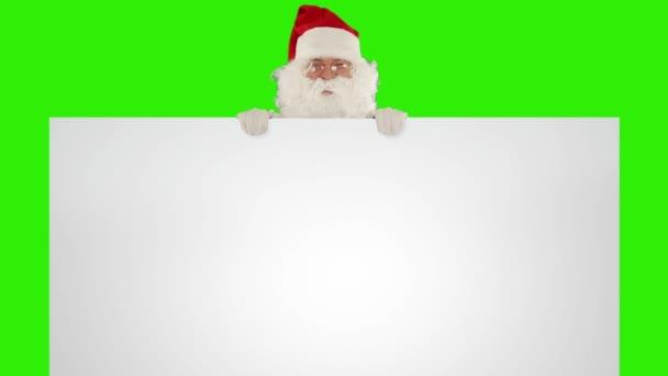 Santa claus se objeví za bílý list
