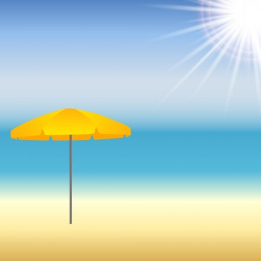 Beach with parasol and sun